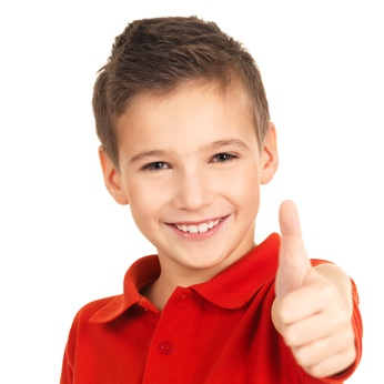 Smiling kid showing thumbs up